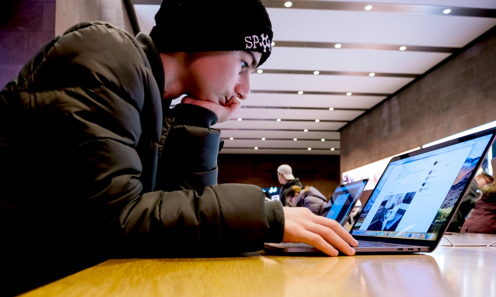 Man Using Macbook